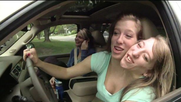Abby and Brittany Hensel driving a car