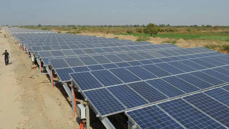 Solar Panels over Canals in India, which prevent water evaporation and increase panel efficiency